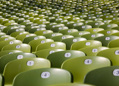 A group of numbered chairs in an auditorium.